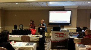 Chris Reed and Kimberly Zelena raffle off prizes at the Help-U-Sell Real Estate Success Summit.